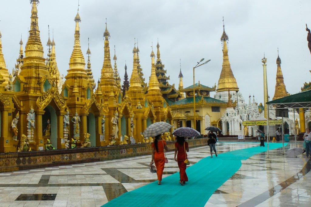Girls with umbrellas in Myanmar