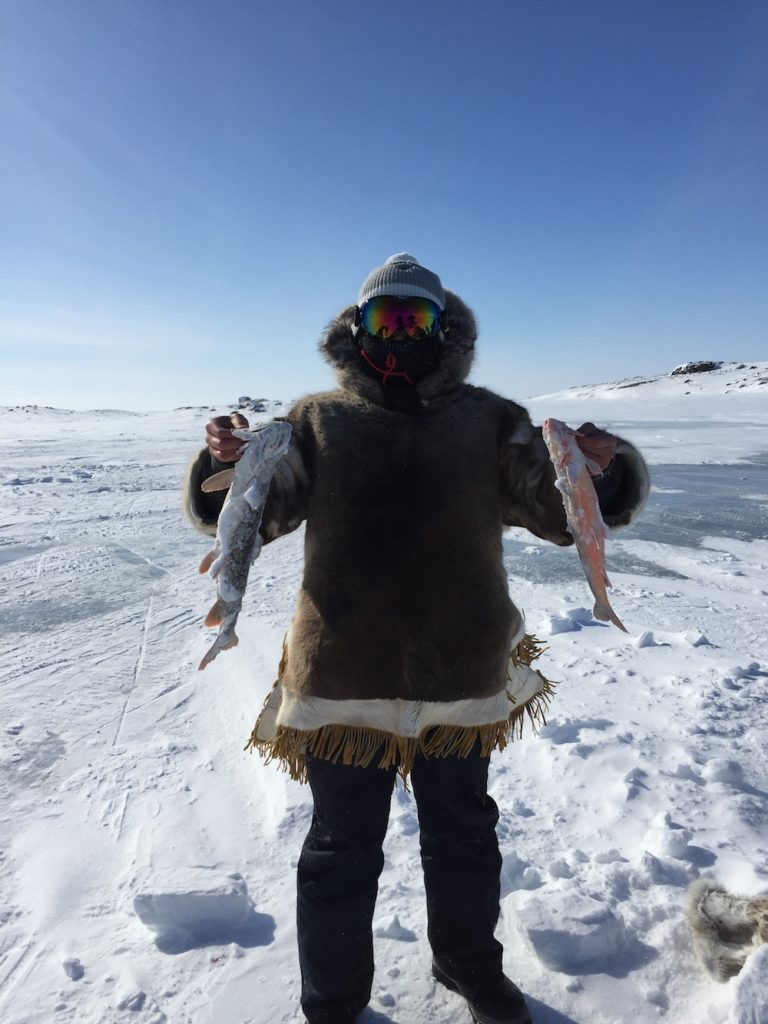 Ice fishing in the Canadian Arctic