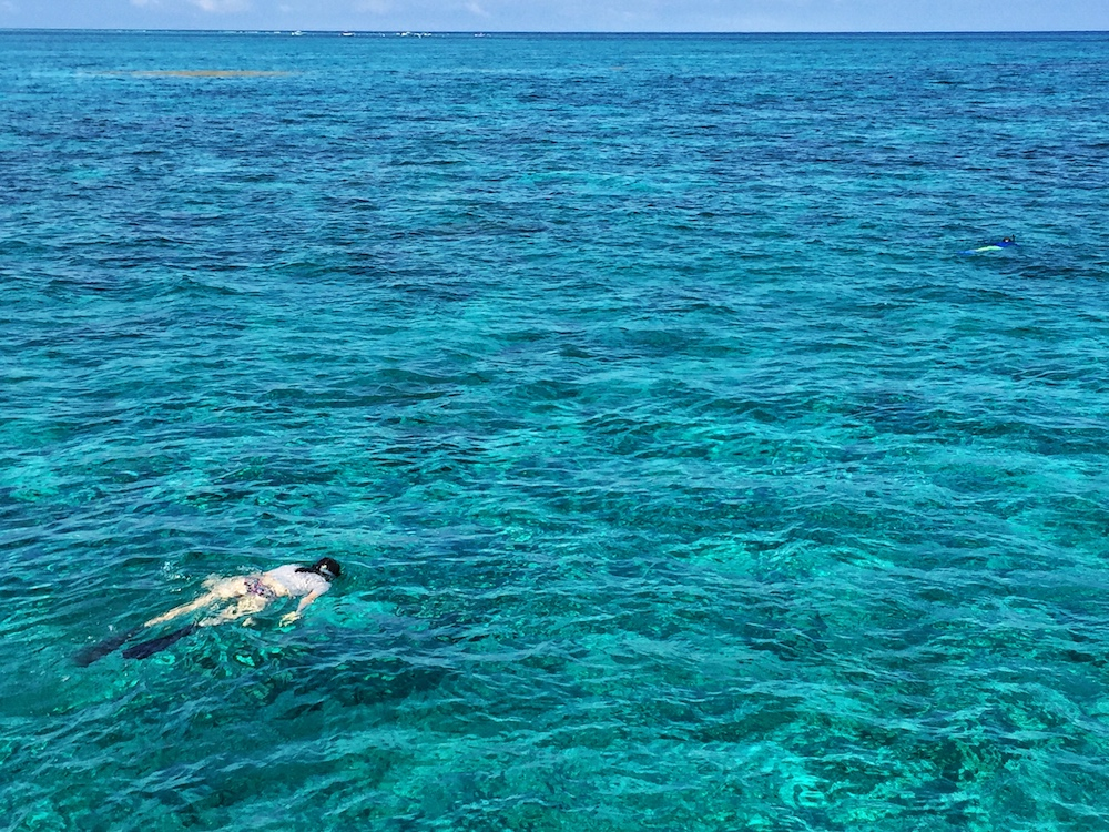 Me snorkeling in Belize in Caye Caulker