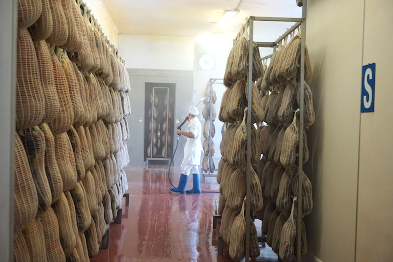 man in prosciutto factory