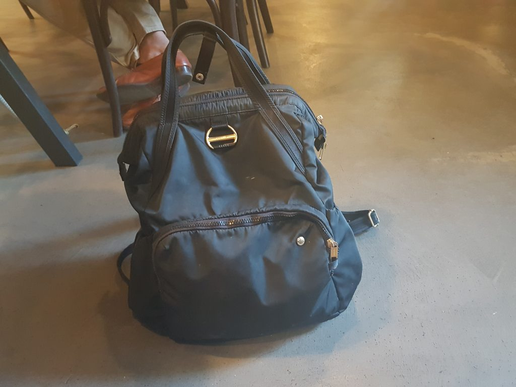 cc680e0cae My personal item bag doubles as my everyday bag and I bring it everywhere —  even the coffee shop I m writing this article from.