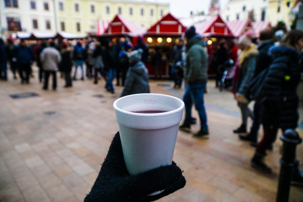 Bratislava in winter / Hand holding cup of hot wine