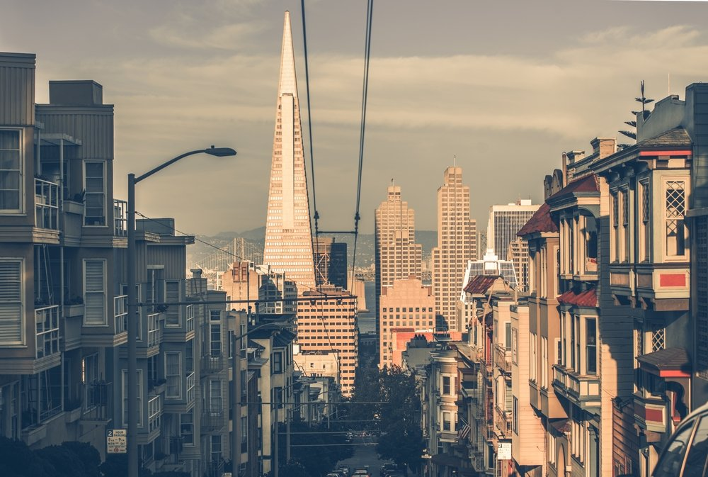 A view of the San Francisco skyline including the triangular, pyramid-shaped TransAmerica building as well as other city buildings.
