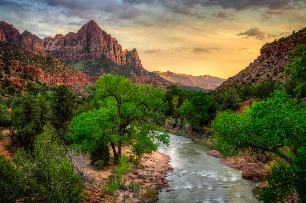 Sunset over Zion National Park with a river and Watchman Mountain