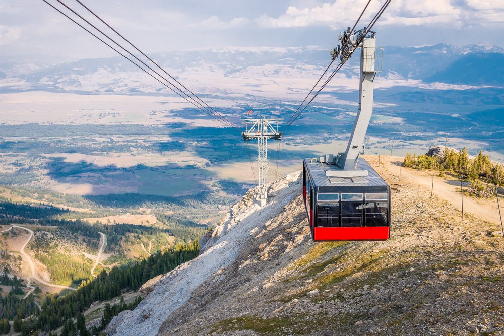 "The famous ""big red"" gondola in Jackson bringing travelers up to the top of the mountain resort"