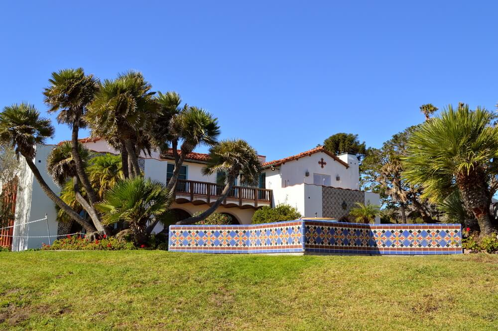 The backyard of the Adamson house with Mediterranean style detailing and tilework and lots of trees