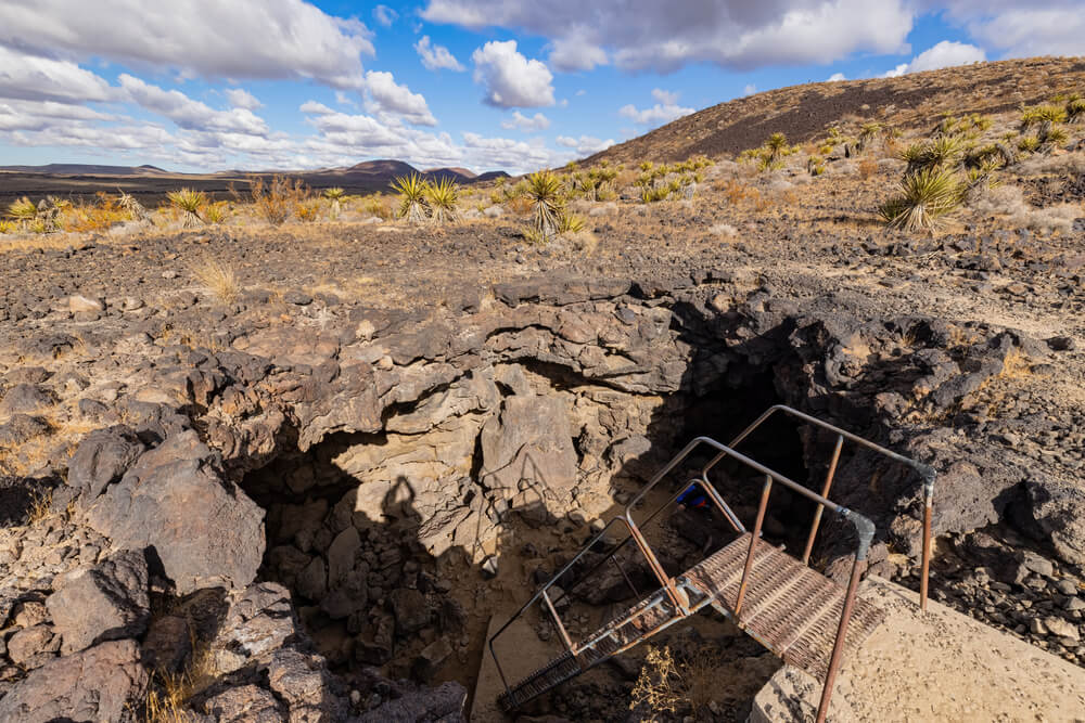 rickety staircase leading down into the lava tube on this mojave national preserve hike