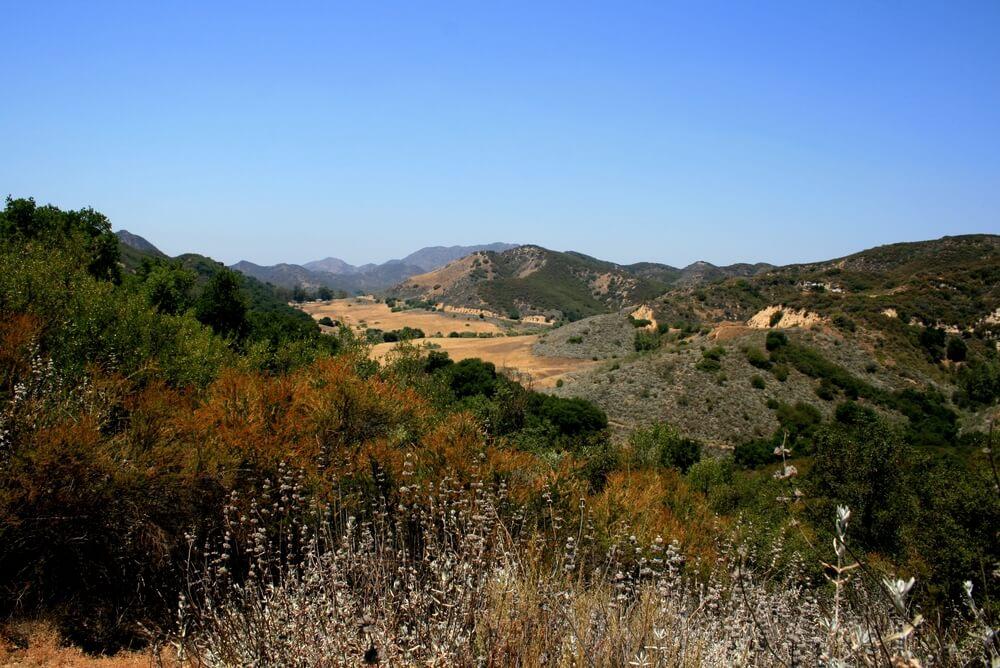 Panoramic view of meadows, hills and sky in Malibu Creek State Park, California