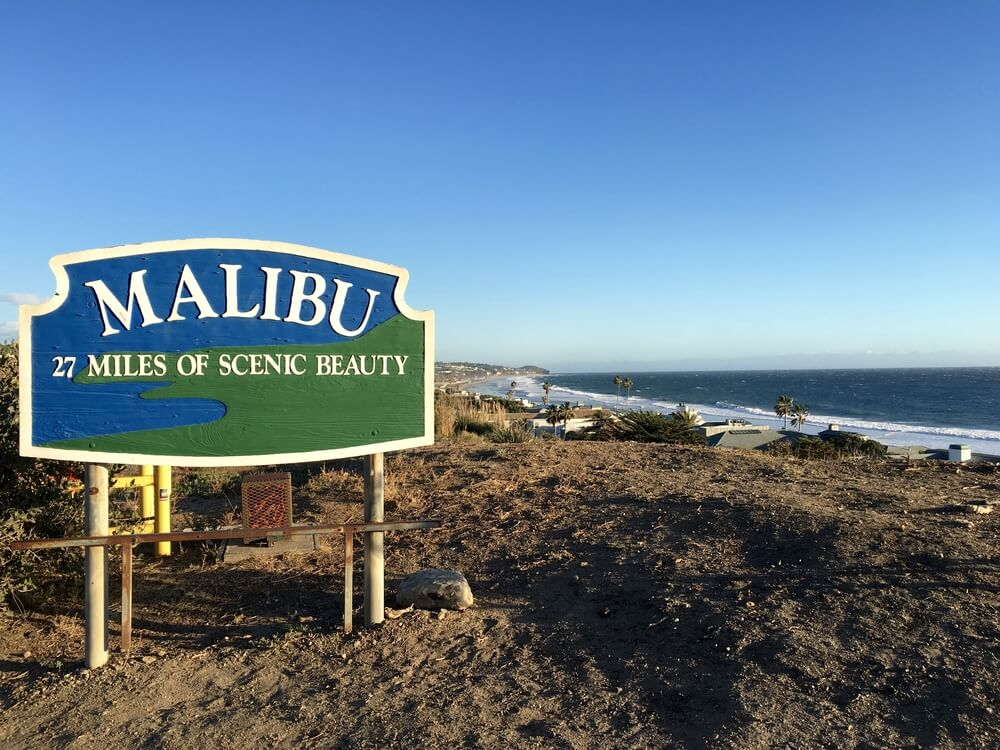 Road sign for Malibu that reads 27 miles of scenic beauty