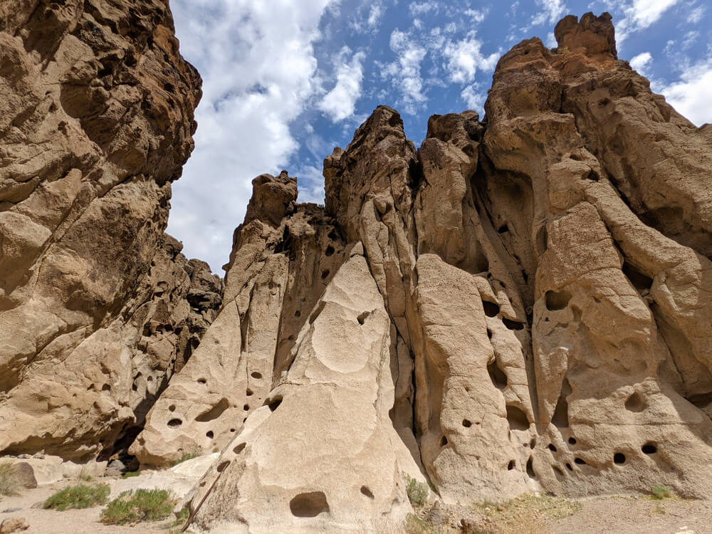 holes in the canyon walls on a popular mojave national preserve hike